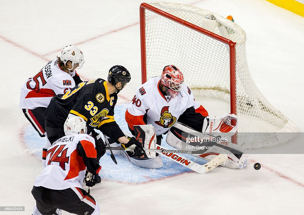 Robin Lehner #40 of the Ottawa Senators makes a save on Zdeno Chara #33 of the Boston Bruins during the third period of an NHL hockey game on December 13, 2014 at TD Garden in Boston, Massachusetts. The Senators won 3-2 in a shootout.