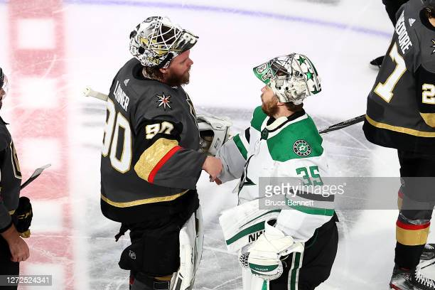 Robin Lehner of the Vegas Golden Knights and Anton Khudobin of the Dallas Stars shakes hands following the Stars 3-2 overtime victory in Game Five of...