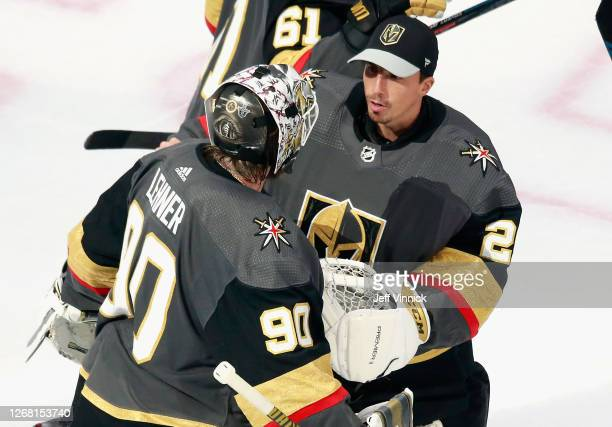 Robin Lehner of the Vegas Golden Knights celebrates his 5-0 shutout against the Vancouver Canucks and is joined by Marc-Andre Fleury in Game One of...