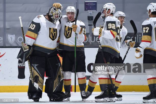 Robin Lehner of the Vegas Golden Knights celebrates their victory with Reilly Smith and teammates during the third period against the Los Angeles...