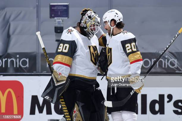 Robin Lehner of the Vegas Golden Knights celebrates their victory with Chandler Stephenson during the third period against the Los Angeles Kings at...