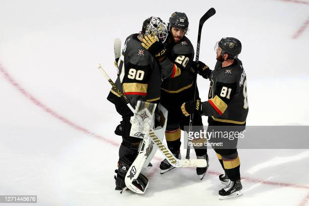 Robin Lehner of the Vegas Golden Knights celebrates with his teammates Chandler Stephenson and Jonathan Marchessault after defeating the Dallas Stars...