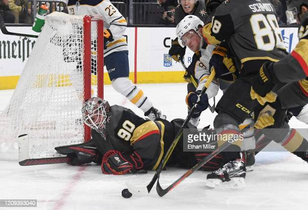 Robin Lehner of the Vegas Golden Knights defends the net against Jack Eichel of the Buffalo Sabres after Lehner made a diving save in the third...