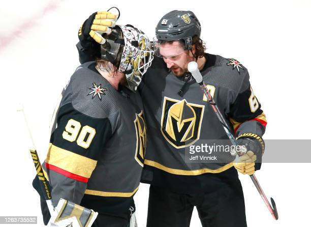 Robin Lehner of the Vegas Golden Knights is congratulated by teammate Mark Stone after they defeated the Dallas Stars 5-2 in a Western Conference...