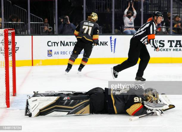 Robin Lehner of the Vegas Golden Knights lies on the ice after giving up a goal to Zack Kassian of the Edmonton Oilers in the third period of their...
