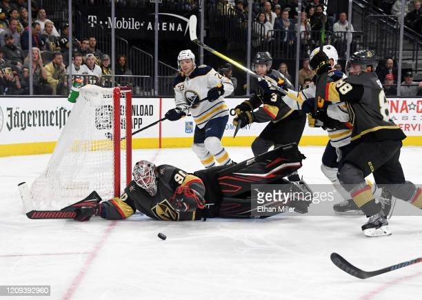 Robin Lehner of the Vegas Golden Knights makes a diving save against the Buffalo Sabres in the third period of their game at TMobile Arena on...