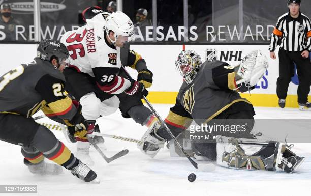 Robin Lehner of the Vegas Golden Knights makes a save against Christian Fischer of the Arizona Coyotes as Alec Martinez of the Golden Knights defends...