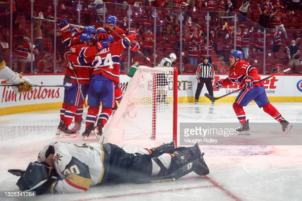 Robin Lehner of the Vegas Golden Knights reacts after allowing the game-winning overtime goal to Artturi Lehkonen of the Montreal Canadiens who is...