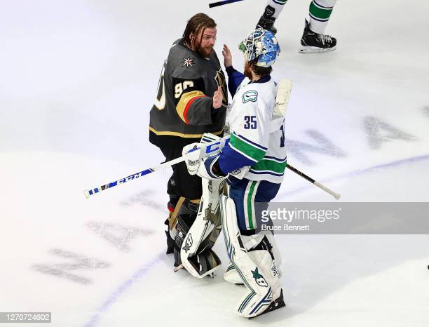 Robin Lehner of the Vegas Golden Knights shakes hands with Thatcher Demko of the Vancouver Canucks after the Golden Knights 3-0 victory in Game Seven...