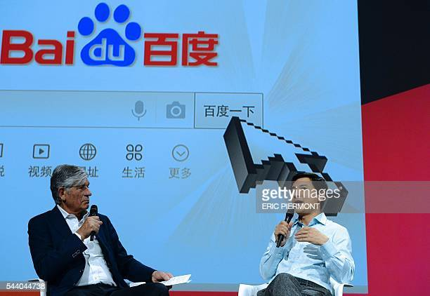 Robin Li founder Chairman and CEO of Baidu talks as Publicis Group Cairman and CEO Maurice Levy listens while attending a session at the Viva...