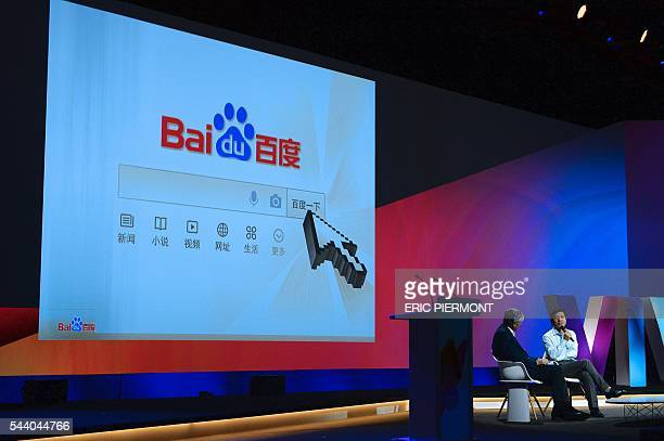 Robin Li , founder, Chairman and CEO of Baidu talks as Publicis Group Cairman and CEO Maurice Levy listens while attending a session at the Viva...