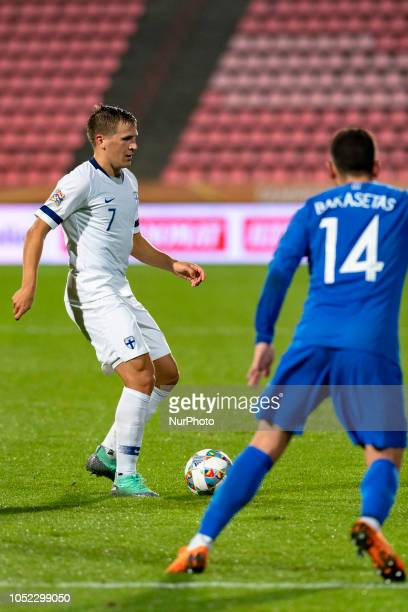 Robin Lod of Finland vies Tasos Bakasetas of Greece during the UEFA Nations League group stage football match Finland v Grece in Tampere Finland on...