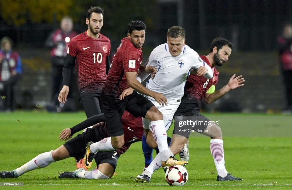 Robin Lod (2nd R) of Finland vies with Ismail Koybasi (2nd L) and Selcuk Inan (R) of Turkey during the FIFA World Cup 2018 qualifying football match between Finland and Turkey in Turku, Southern Finland on October 9, 2017. / AFP PHOTO / Lehtikuva / Antti Aimo-Koivisto / Finland OUT