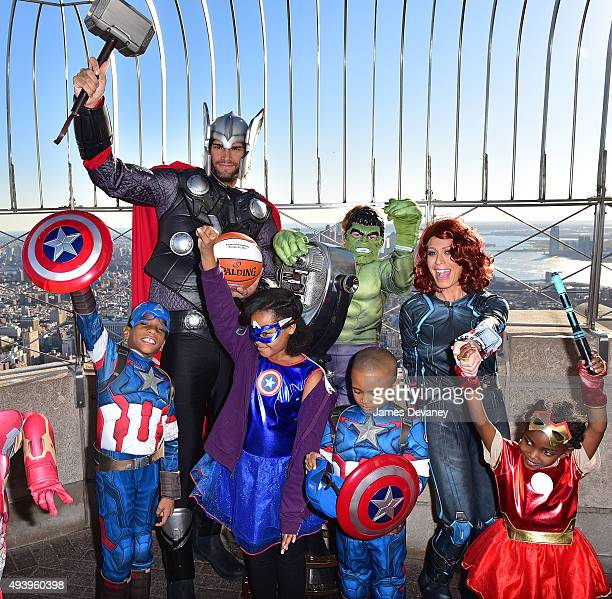 Robin Lopez Jill Martin and children from the Garden of Dreams Foundation visit the Empire State Building on October 23 2015 in New York City