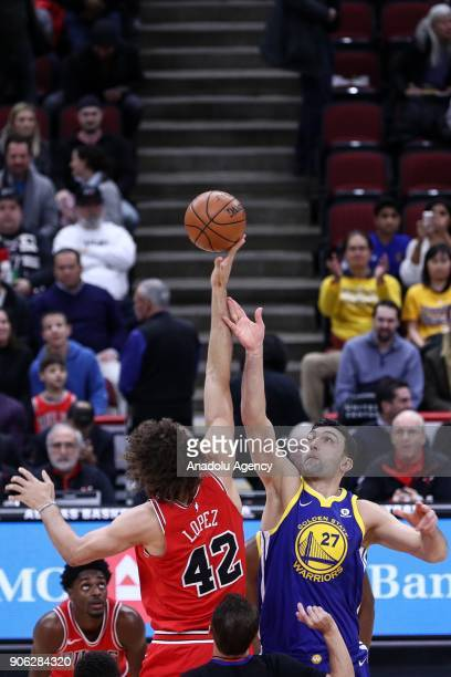 Robin Lopez of Chicago Bulls in action against Zaza Pachulia of Golden State Warriors during the NBA basketball match between Chicago Bulls and...