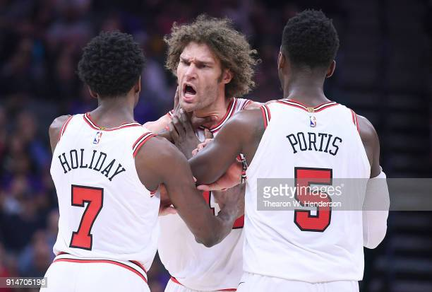 Robin Lopez of the Chicago Bulls argues over a foul called by referee Rodney Mott during an NBA basketball game against the Sacramento Kings at...