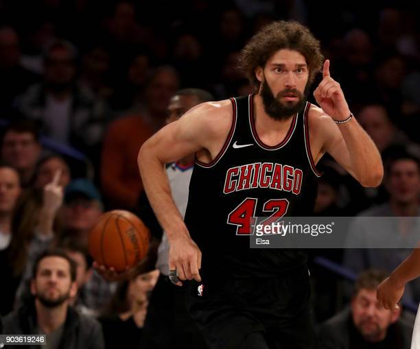 Robin Lopez of the Chicago Bulls celebrates his dunk in the second overtime period against the New York Knicks at Madison Square Garden on January 10...