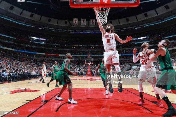 Robin Lopez of the Chicago Bulls dunks against the Boston Celtics during the game on February 16 2017 at the United Center in Chicago Illinois NOTE...