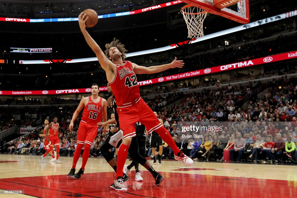 San antonio spurs v chicago bulls robin lopez 42 of the chicago bulls grabs a rebound in the first quarter against voltagebd Image collections