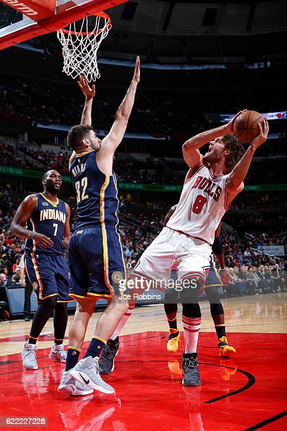 Robin Lopez of the Chicago Bulls looks to shoot the ball against Georges Niang of the Indiana Pacers during a game on October 29 2016 at the United...