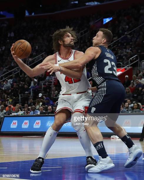 Robin Lopez of the Chicago Bulls looks to shoot the ball as Blake Griffin of the Detroit Pistons defends during the first half of the game at Little...