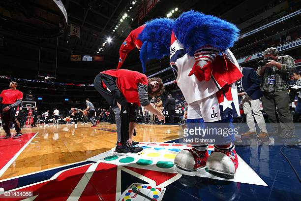 Robin Lopez of the Chicago Bulls plays twister with the Washington Wizards mascot before the game on January 10 2017 at Verizon Center in Washington...