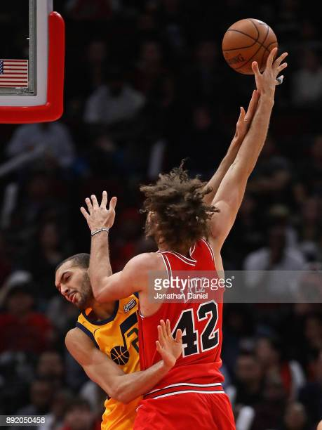 Robin Lopez of the Chicago Bulls shoots against Rudy Gobert of the Utah Jazz at the United Center on December 13 2017 in Chicago Illinois The Bulls...