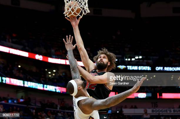 Robin Lopez of the Chicago Bulls shoots over Dante Cunningham of the New Orleans Pelicans during the first half of a NBA game at Smoothie King Center...