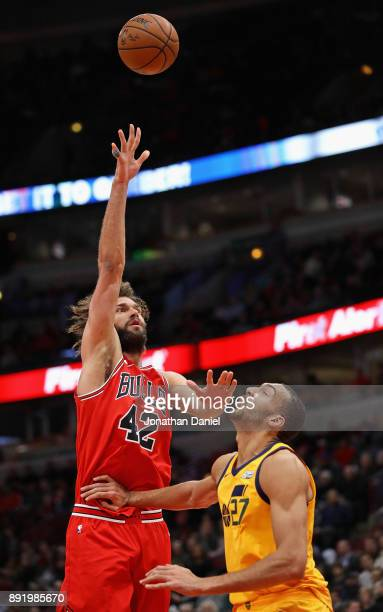 Robin Lopez of the Chicago Bulls shoots over Rudy Gobert of the Utah Jazz at the United Center on December 13 2017 in Chicago Illinois NOTE TO USER...