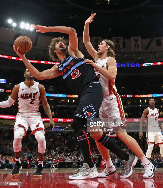 Robin Lopez of the Chicago Bulls tries to get off a shot against Kelly Olynyk of the Miami Heat at the United Center on November 23, 2018 in Chicago,...