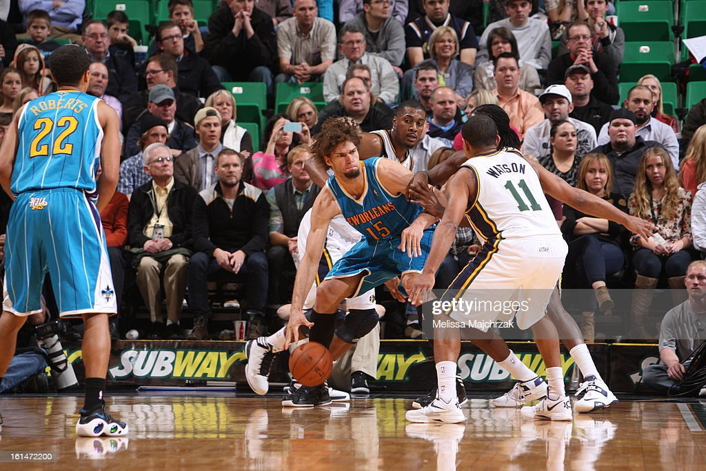 Robin Lopez #15 of the New Orleans Hornets backs up to the basket against Earl Watson #11 of the Utah Jazz at Energy Solutions Arena on January 30, 2013 in Salt Lake City, Utah.