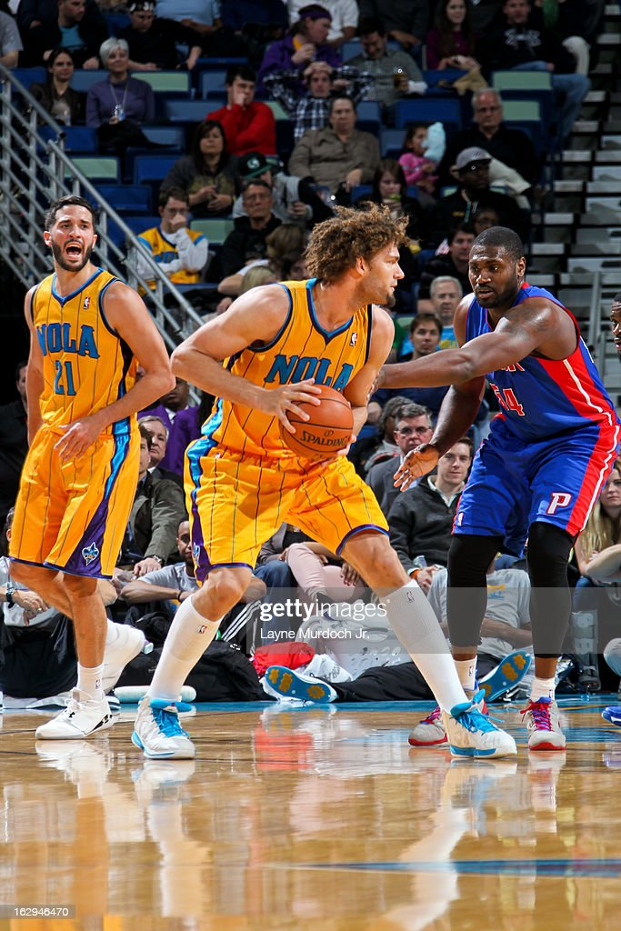 Robin Lopez #15 of the New Orleans Hornets controls the ball against Jason Maxiell #54 of the Detroit Pistons on March 1, 2013 at the New Orleans Arena in New Orleans, Louisiana.