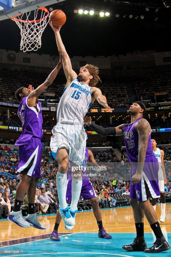 Robin Lopez #15 of the New Orleans Hornets drives to the basket against John Salmons #5 and DeMarcus Cousins #15 of the Sacramento Kings on February 24, 2013 at the New Orleans Arena in New Orleans, Louisiana.