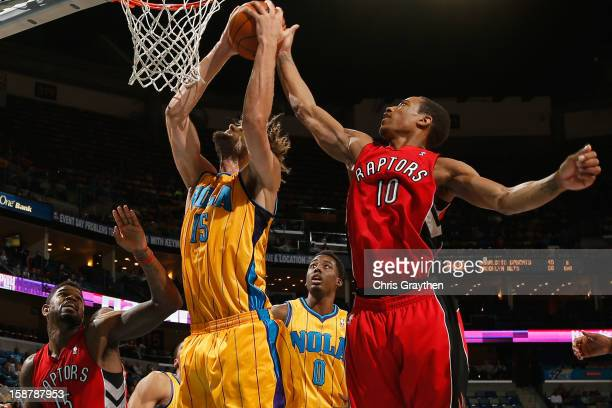 Robin Lopez of the New Orleans Hornets fights for a rebound with DeMar DeRozan of the Toronto Raptors at New Orleans Arena on December 28 2012 in New...