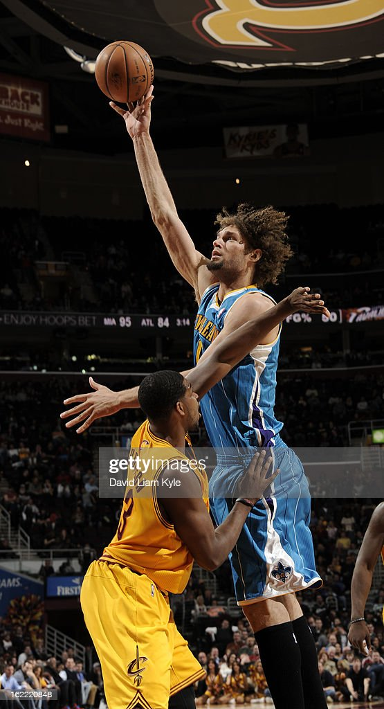Robin Lopez #15 of the New Orleans Hornets goes up for the shot against Tristan Thompson #13 of the Cleveland Cavaliers at The Quicken Loans Arena on February 20, 2013 in Cleveland, Ohio.