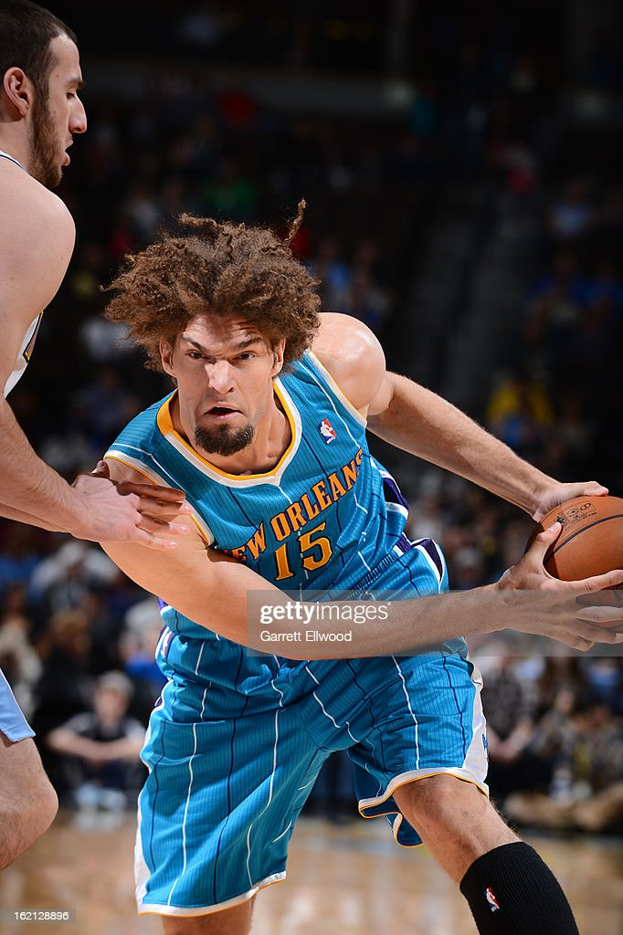 Robin Lopez #15 of the New Orleans Hornets makes a move against Kosta Koufos #41 of the Denver Nuggets on February 1, 2013 at the Pepsi Center in Denver, Colorado.