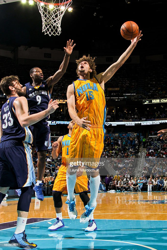 Robin Lopez #15 of the New Orleans Hornets shoots in the lane against Marc Gasol #33 and Tony Allen #9 of the Memphis Grizzlies on March 22, 2013 at the New Orleans Arena in New Orleans, Louisiana.