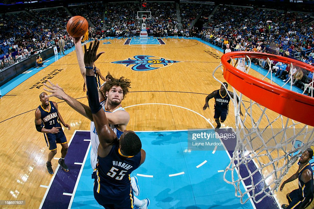 Robin Lopez #15 of the New Orleans Hornets shoots in the lane against Roy Hibbert #55 of the Indiana Pacers on December 22, 2012 at the New Orleans Arena in New Orleans, Louisiana.