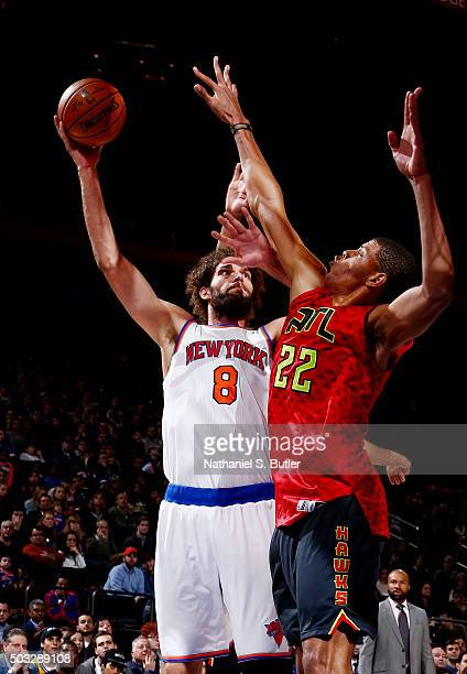 Robin Lopez of the New York Knicks shoots against Walter Tavares of the Atlanta Hawks during the game on January 3 2016 at Madison Square Garden in...
