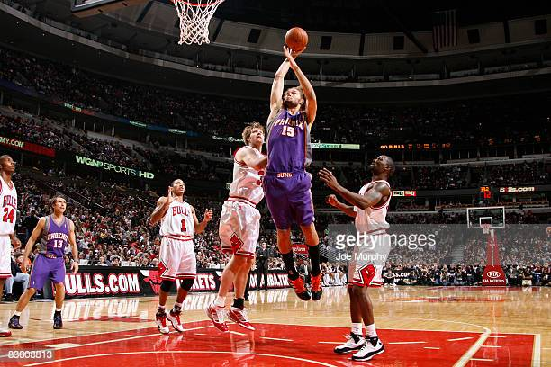 Robin Lopez of the Phoenix Suns goes for a dunk past Aaron Gray and Ben Gordon of the Chicago Bulls during the NBA game on November 7, 2008 at the...