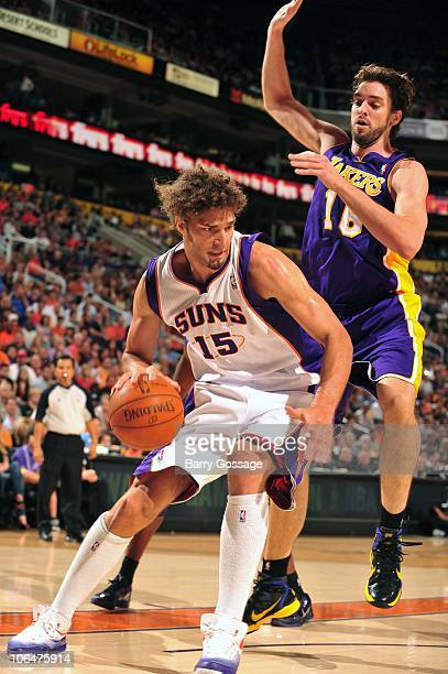 Robin Lopez of the Phoenix Suns looks for an opening while under pressure  from Sasha Vujacic 8b26153f9