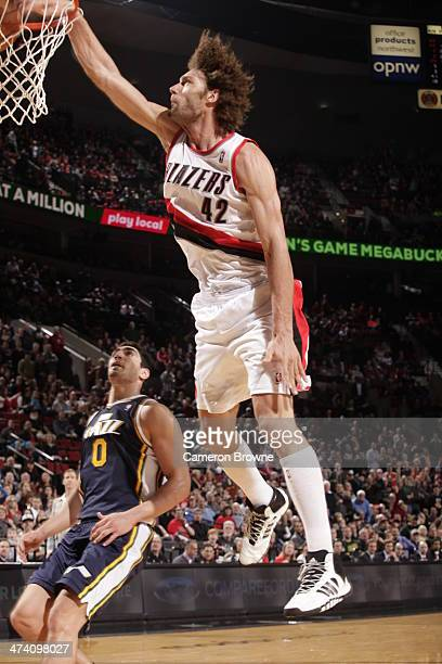 Robin Lopez of the Portland Trailblazers dunks the ball against the Utah Jazz on February 21 2014 at the Moda Center Arena in Portland Oregon NOTE TO...