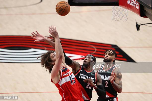 Robin Lopez of the Washington Wizards battles for possession against Robert Covington and Gary Trent Jr. #2 of the Portland Trail Blazers in the...