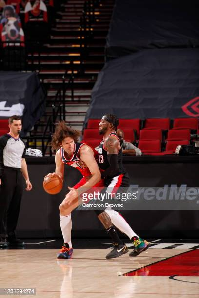 Robin Lopez of the Washington Wizards dribbles during the game as Robert Covington of the Portland Trail Blazers plays defense on February 20, 2021...