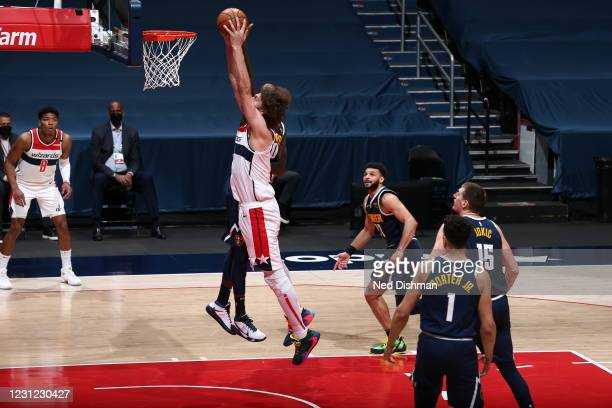 Robin Lopez of the Washington Wizards drives to the basket during the game against the Denver Nuggets on February 17, 2021 at Capital One Arena in...