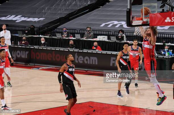 Robin Lopez of the Washington Wizards dunks the ball during the game against the Portland Trail Blazers on February 20, 2021 at the Moda Center Arena...