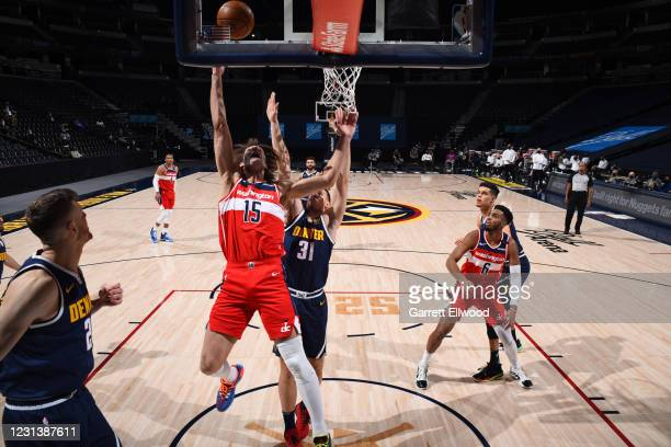 Robin Lopez of the Washington Wizards shoots the ball against the Denver Nuggets on February 25, 2021 at the Ball Arena in Denver, Colorado. NOTE TO...