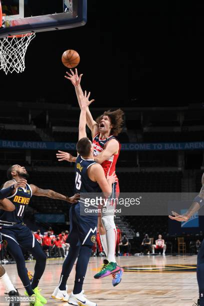 Robin Lopez of the Washington Wizards shoots the ball the game against the Denver Nuggets on February 25, 2021 at the Ball Arena in Denver, Colorado....