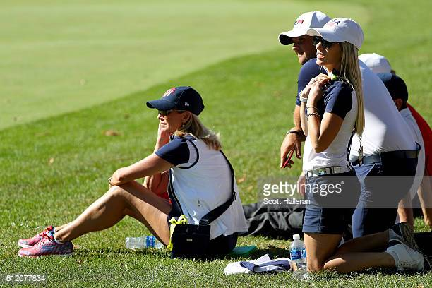 Robin Love Justine Reed and Patrick Reed of the United States look on during singles matches of the 2016 Ryder Cup at Hazeltine National Golf Club on...