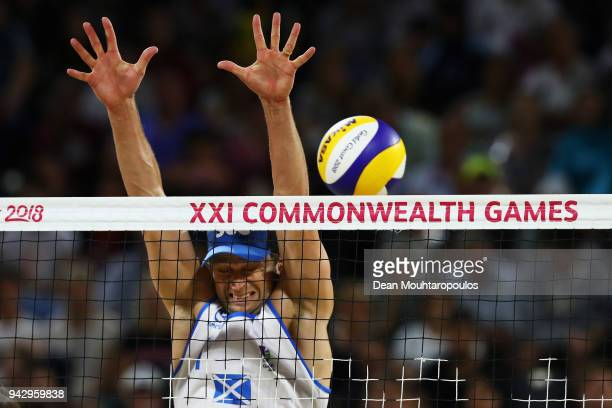 Robin Miedzybrodzki of Scotland attempts a block against Aboubakar Kamara and Patrick Lombi of of Sierra Leone during the Mens Beach Volleyball...
